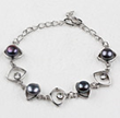http://www.aliexpress.com/store/product/Trendy-Design-Black-Freshwater-Pearl-and-Eye-Shape-Metal-Bracelet/703253_1806784245.html