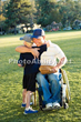 Father in Wheelchair Plays Baseball with Son in Park
