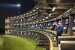 A golfer tees off at Topgolf