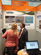 William Smith, Infinity Fuel Cell and Hydrogen, Inc. of South Windsor, Conn., talks with attendees at Hannover Messe 2014.
