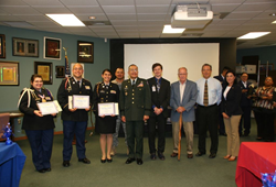 Winners and Judges Left to right: Madelyne Killelea, third place, Christian Mendoza, second place and  Brianna Seratto, first place, Major General Charles Rodriguez, Corey Ryan, Colonel Norris Miller Overly, Dr. Juan D. Villarreal, Casandra Garcia,  back