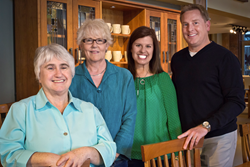 McKinnon Furniture co-founders Sheila McKinnon and Theresa Schneider, with new owners Susan and Gary Strand.