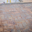 Stamped concrete colored with waterbase stain