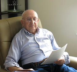 Solomon Spierer holds his memoir manuscript in his apartment at the senior living community in Whippany, N.J.