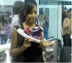 A participant in the first Shiekh Shoes Design a Shoe contest shoes off her artwork at a Shiekh Shoes location in Sacremento.