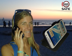 Sylvia at the beach using the latest in RF Safe's 2014 summer line of radiation shielded cell phone flip cases!