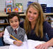 Christopher receives some personal attention from first grade teacher at Everest Academy.
