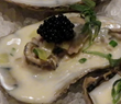 Poached oyster with leeks, cream, and Black River Russian caviar