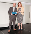 Tony Bracey, Multi Agency Information Transfer (MAIT) Project Manager, at the Joint Emergency Services Group, receiving his Award from Helen Platts, Head of Finance and Business Management at the Local Government Association