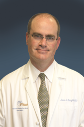 John J. Knightly, MD