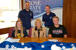 Rose State College President Jeanie Webb with new soccer team signees. Front, L-R; Kyla Nicole Sharry, President Jeanie Webb, Skyler Blake Walker. Back, L-R: Coach Damon Solomon, Coach Billy Martin