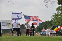 Marchers walk to end racial hatred and honor those who perished in the Holocaust