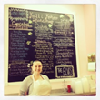 A menu board full of delicious sweets at Kelli Kakes