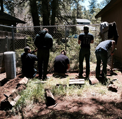 Back2Basics rehab residents build a chicken coop onsite.