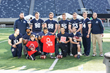 Football players from Kean University volunteered to man the on-field kids activities in the end zone