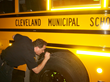 Ohio state inspector John Rose examines one of Cleveland School's new school buses fueled by clean and economical propane autogas.