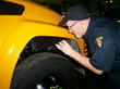 Ohio state inspector, Chip Hilling, inspects Cleveland Schools' new Blue-Bird propane autogas buses.
