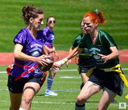 Brunettes carry the ball down the football field during YPAAC's BvB Flag Football game.