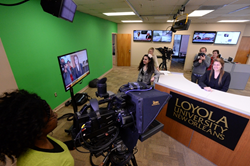 School of Mass Communication students work in a new multimedia newsroom.