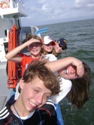 Summer family vacation fun on a Dauphin Island Sea Lab Center discovery cruise in Mobile Bay.