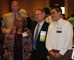 Pictured left to right are Bill Crowder (standing), Irma Patterson, CEO Craig Bass and Yussef Farag.