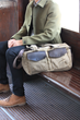 The Outback Duffel—lifestyle; waxed canvas with grizzly leather accents