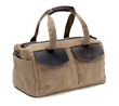 The Outback Duffel—waxed canvas with chocolate brown leather; size small