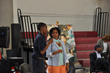 Chester Community Charter School (CCCS) eighth-grader Vatangoe Donzo (left) stands with Syreeta Martin, journalist and consultant (right), during a question-and-answer session at the school's recent F