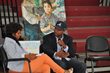 Grammy-award-winning producer/songwriter Carvin Haggins (right) answers a question from Syreeta Martin, journalist and consultant (left), during a question-and-answer session at Chester Community Char
