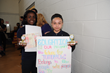 "Chester Community Charter School seventh-graders, Tiana Watkins (left) and Megan Magallanes (right), were two of six recipients, who were awarded trophies for their ""social issues"" posters at the scho"