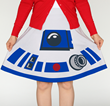 "You'll look ""geek chic"" when you add this R2-D2 skirt to your Star Wars wardrobe. The plucky little droid will save the day when you're looking for that perfect piece to mix and match."