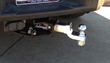 Unique Hitch Stows Under Truck with Push of Button