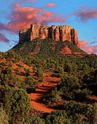 Polpular red rock formation Courthouse Butte glows during sunset