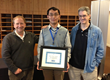 Professor Greg Ganger (right) and Dr. John Busch SanDisk Vice President and Fellow (left) congratulate Jinglei Ren, Winner of Best Graduate Student Poster.