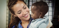 Molly Gacetta, from Seattle, Washington, holds a young patient on board the Africa Mercy.