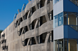 Longitudinal and latitudinal curves of woven metal fabric from Cambridge Architectural enhance the parking garage at Cincinnati Children's Hospital.