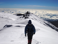 Climber near Uhuru Peak, Mount Kilimanjaro's summit.