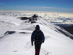 Climber near Uhuru Peak, Mount Kilimanjaro's summit.