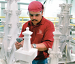 O&G's staff artist finishes the restoration of Trinity College pinnacle