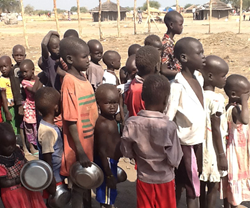 Children wait for cooked food in Awerial Camp, South Sudan