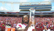 Jadeveon Clowney lifts the 2012 CFPA Defensive Lineman Trophy