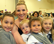 Moms and children enjoy the Mother's Day Tribute at Everest Academy in Lemont, IL.