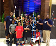 Chess Team Celebrates with Coaches