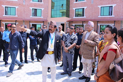 Basanta Kunwar with Nepal Dep Prime Minister Krishna Bahdur Mahara in front of the new Narconon drug rehab complex