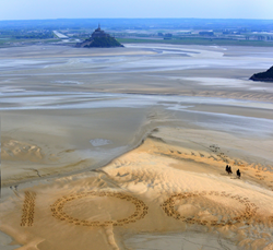 Giant 2.3m by 2.5m horse hoof prints created in the Bay of Mont-Saint-Michel, the famous UNESCO World Heritage Site, by French artist and sand sculptor Christophe Dumont, mark 100 days to the start of the Alltech FEI World Equestrian Games™ 2014 in Norman