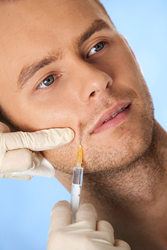 Man getting wrinkle-relaxing injection