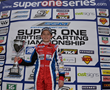 Tom Wood celebrates on the podium at Rowrah