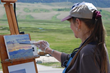 An artist creates at the annual June Plein Air Fest in Jackson Hole at the National Museum of Wildlife Art.