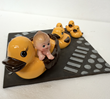 The Conrad Hotel has a yellow ducky in each bathroom - Poller takes it to bed in bronze