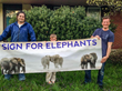 From left, Jake Roberts of Newark, Delaware; Henry Govette and his father, Will Govette of Thorton, Pennyslvania, sign for elephants this May calling for the president to ban all ivory for-profit trad